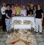 Gathering around the altar on Bread of Life Sunday Liturgy on August 20, 2006